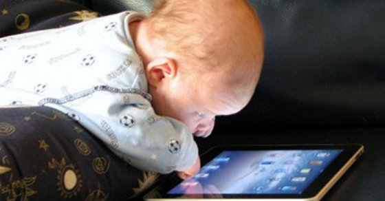 baby looking at tablet