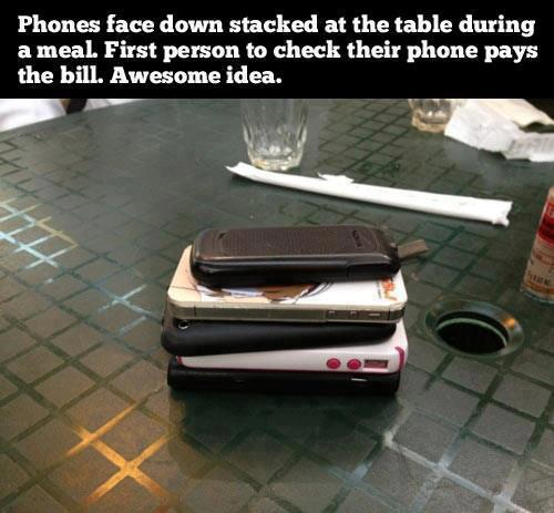 Phones stacked down at meal. First to answers pays for everyone.