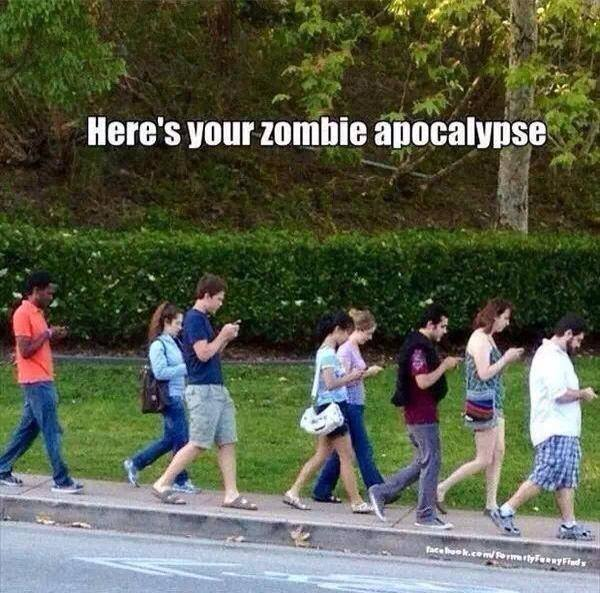 Here's your zombie apocalypse (Everyone walking has their heads looking down at their smartphones).